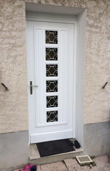 Rénovation d'une porte d'entrée bois par une porte d'entrée PVC KOMMERLING